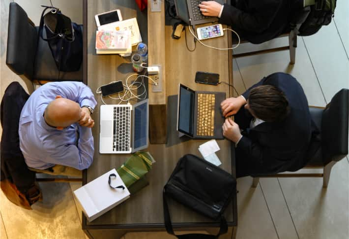 Two men working in a relaxed enviroment